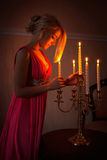 The girl with a candlestick Royalty Free Stock Photography