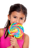 Girl with a candy Royalty Free Stock Photos