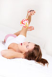 Girl with a candy Stock Photos