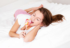 Girl with a candy Royalty Free Stock Image
