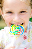 Girl with candy Royalty Free Stock Image