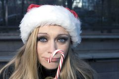 Girl with candy cane royalty free stock image