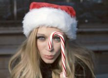 Girl with candy cane Royalty Free Stock Images