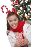 Girl with candy cane antlers Stock Image