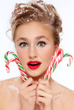 Girl with candy canes Royalty Free Stock Image
