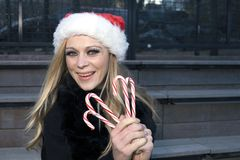 Girl with candy canes Royalty Free Stock Images