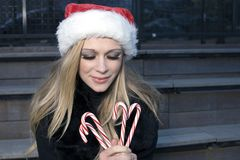 Girl with candy canes Royalty Free Stock Photo