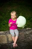 Girl with candy floss Royalty Free Stock Photography