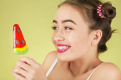 Girl with candy Stock Images