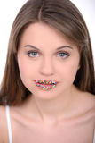 Girl and Candy. Woman with lips painted candy on white background Stock Photos