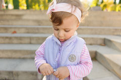 Girl with Candy Wrapping Stock Image