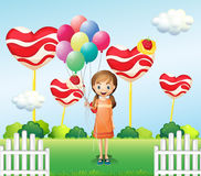 A girl in the candyland with eight balloons. Illustration of a girl in the candyland with eight balloons Royalty Free Stock Photos