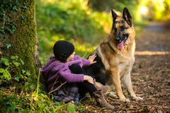 A Girl and a Canine Friend Royalty Free Stock Image