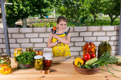 Girl with Canning Supplies Outdoors in Garden Stock Photo