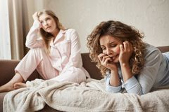 Girl cannot handle pressure, feeling miserable and sad. Gloomy crying woman lying in nightwear on sofa, whining and. Girl cannot handle pressure, feeling royalty free stock images