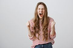 Girl cannot hide her depression and negative emotions. Portrait of stressed fed up female coworker screaming out loud royalty free stock photo