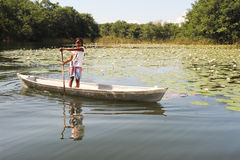 Girl on canoe at isla de las flores on river Dulce Royalty Free Stock Images