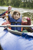 Girl in canoe. Summer time Stock Images