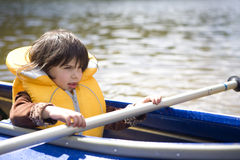 Girl canoeing Stock Image