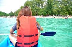 Girl canoeing Stock Photography