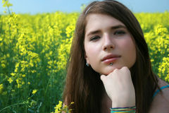 Girl at the canola field Royalty Free Stock Images