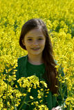 Girl in canola field Stock Photos