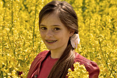 Girl in canola field Stock Image