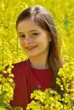 Girl in canola field Stock Photo