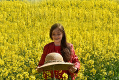 Girl in canola field Royalty Free Stock Photography
