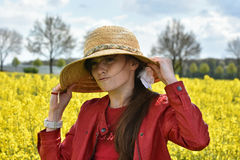 Girl in canola field Royalty Free Stock Photos