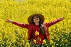 Girl in canola field Stock Photos