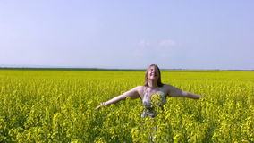 Girl and canola field stock video