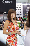 A girl on Canon stand at Photo&Imaging 2012 Seoul. A cover girl posing on Canon stand at Industry Show in Seoul Royalty Free Stock Photos