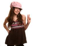 The girl in a cap. The girl in a pink cap smiles and looks in a camera Stock Photos