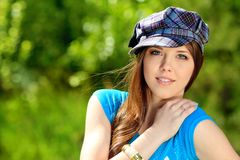 Girl in cap Royalty Free Stock Photography