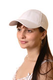 Girl in cap. Dark hair girl in white cap Royalty Free Stock Images