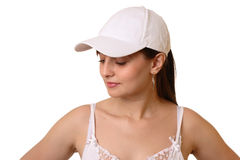 Girl in cap. Dark hair girl in white cap, look aside Stock Photo