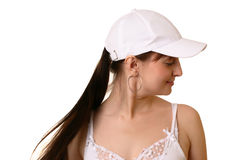 Girl in cap. Dark hair girl in white cap, look aside Stock Image