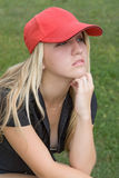 Girl with cap. Girl with red baseball cap Royalty Free Stock Photography