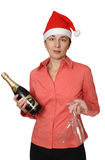 The girl in a cap. The girl in a red cap holds a bottle of a champagne and two wine glasses Stock Photos