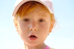 Girl in a cap Royalty Free Stock Image