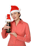 The girl in a cap. The girl in a red cap holds a bottle of a champagne Royalty Free Stock Photos