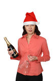 The girl in a cap. The girl in a red cap holds a bottle of a champagne and two wine glasses Royalty Free Stock Photo