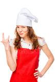 Girl in a cap and apron showing hand gesture Royalty Free Stock Images