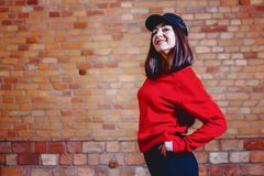 girl in cap at background of brick wall royalty free stock photography