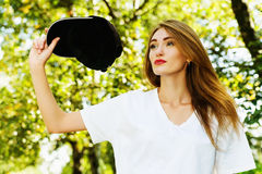 Girl with cap. Beautiful girl with long hair and black cap, walking outdoor Royalty Free Stock Image