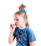 The girl in a cap blows in a whistle Stock Images