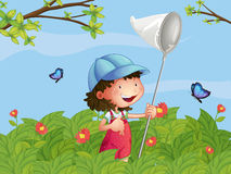 A girl with a cap catching butterflies Royalty Free Stock Images