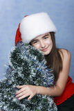 Girl in a cap with the Christmas Royalty Free Stock Photo