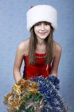 Girl in a cap with the Christmas Stock Photography